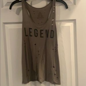 Super soft tank top with distressed holes. Size S